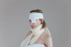 Bandaged injured sex slave