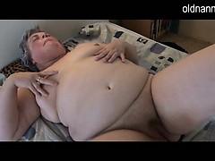 fat-granny-masturbating-with-long-black-dildo