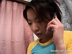 japanese-teen-sweetie-in-hot-outfit-having-phone-sex