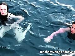 three-girls-swimming-nude-in-the-sea