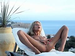 mega-skinny-girl-toying-on-the-sunbed