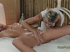 blonde-masseuse-rubbing-and-oiling-pussy-to-brunette-hottie