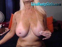 big-boobed-granny-stretches-her-pussy-1