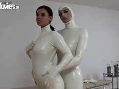 naughty-babes-in-white-latex-fondling-each-other