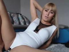 slim-blonde-babe-with-nice-legs-fingering-herself