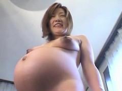 oriental-preggo-plays-with-her-tits