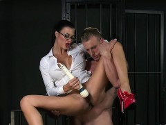 busty-mistress-gives-blowjob-to-her-sub-in-cage