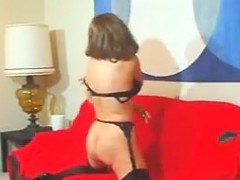 granny having fun on the bright red couch granny sex movies
