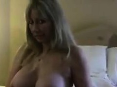 blonde-woman-shows-off-her-big-breasts