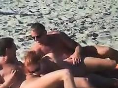 swingers-having-fun-outdoors-at-a-beach