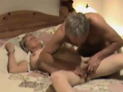older-british-couple-in-bed-doing-oral