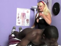 mature-blonde-doctor-aids-black-athlete-in-her-office