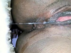 Black babe masturbates and squirts - closeup