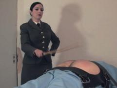 uniformed-dominatrix-canes-useless-sub