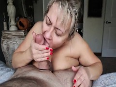 busty-mature-wife-sucks-a-big-fat-cock-on-her-knees