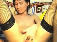 slim-mature-whore-fingering-her-pussy