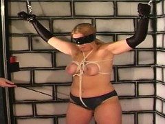busty-blonde-masochist-is-tied-and-pounded-in-dungeon