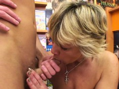 sexy-blonde-mature-fucks-him-in-the-video-store