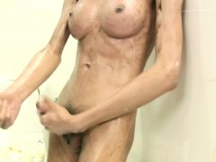 short-haired-ladyboy-sits-on-toilet-and-sucks-big-cock-cum