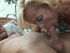 sexy-mature-blonde-gobbles-young-cock-and-fucked