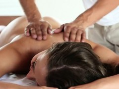 naked-brunette-oiled-up-on-massage-table