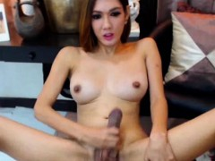 cute-shemale-with-big-tits-masturbates-her-big-cock