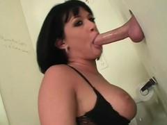 busty-slut-fellating-dick-with-lust-on-gloryhole