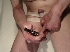 weird-dude-tapes-up-his-dick-while-he-strangles-his-nut-sac