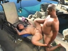 busty-redhead-takes-great-pleasure-in-stuffing-a-black-pole-in-her-ass