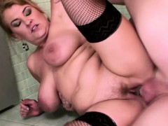 brunette-mature-gets-pissed-on-in-a-restroom