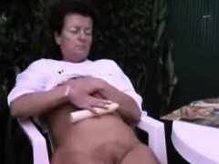 brunette-masturbates-outside-together-with-her-toy