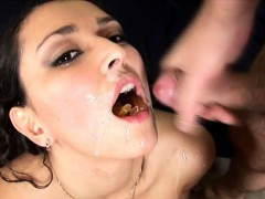 Brunette babe Mikaela takes on two dicks and swallows a mouthful