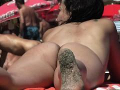 uninhibited-young-woman-enjoys-sunbathing-without-her-swims