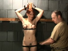 busty-redhead-is-tied-to-a-cross-for-bondage-sex