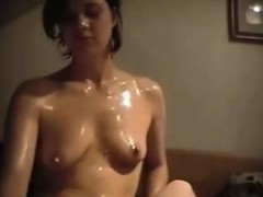 oiled-brunette-girlfriend-patting-and-stroking-his-penis-th