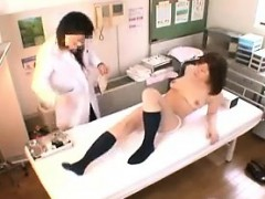 big titted asian cutie is naked on the exam table getting her cu
