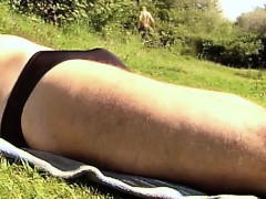 Sunbath In A Field In Brief That Is Black