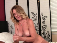 classy-milf-stroking-dick-with-both-hands