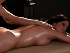 two cute women licking each pussies on massage table