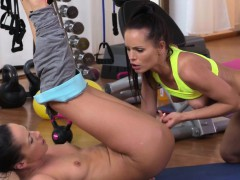 Stunning lesbians licking in fitness gym