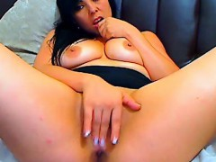 busty-brunette-masturbates-with-a-dildo-on-the-couch