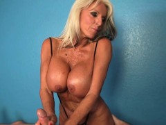 mature-masseuse-wanks-with-hands-and-boobs