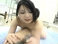 alluring japanese masseuse pleases a stiff penis with her gi