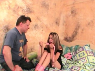 Brunette teen gets tied and photographed by stud