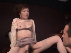 beautiful older playgirl jerks off a hard penis on her tits