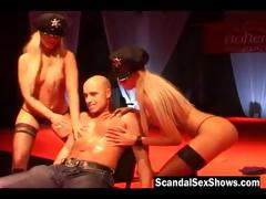 two-blonde-female-cops-strip-on-stage