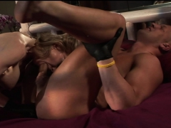 blonde milf uses a strapon on him