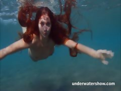 julia-is-swimming-underwater-nude-in-the-sea