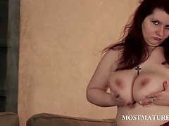 Mature Hoe Rubs Huge Tits In Close up