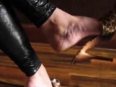 teasing-her-feet-in-exotic-high-heels